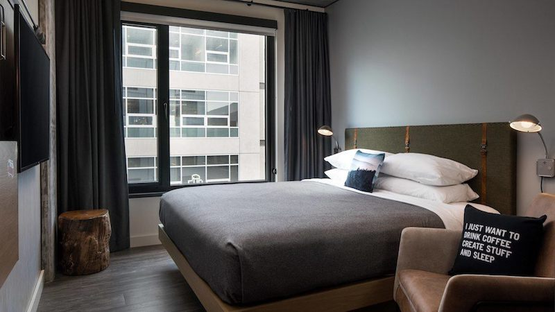 guest room of Moxy Seattle hotel